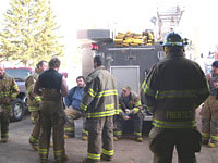 Debriefing live house burn practice